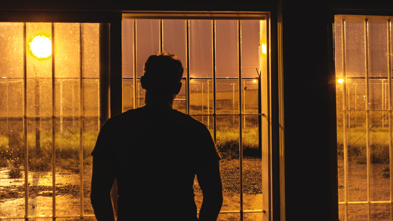 abraham-woroniecki-looking-through-prison-window