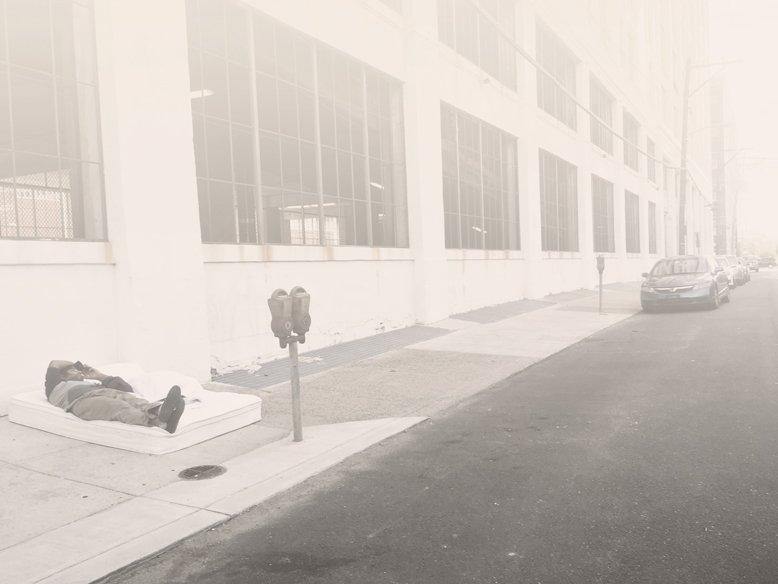 man-sleeping-on-street