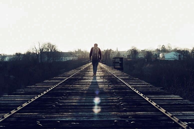 man-walking-train-tracks-michael-woroniecki-blog